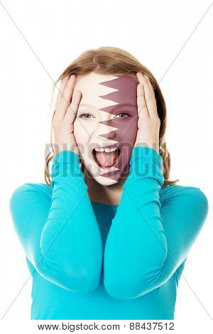 Woman with Qatar flag painted on face.