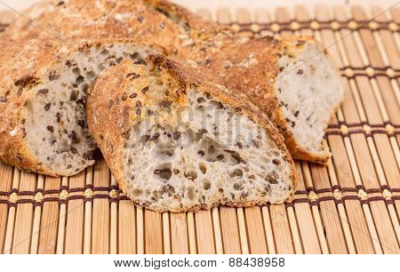 Brown bread with seeds on a table.