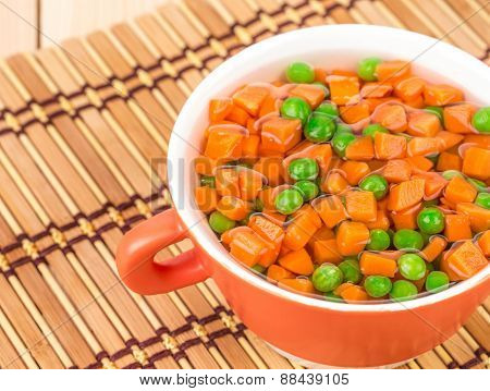 Peas and carrots close up.