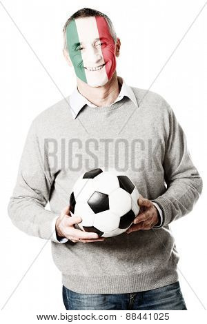 Mature man with Mexico flag painted on face.