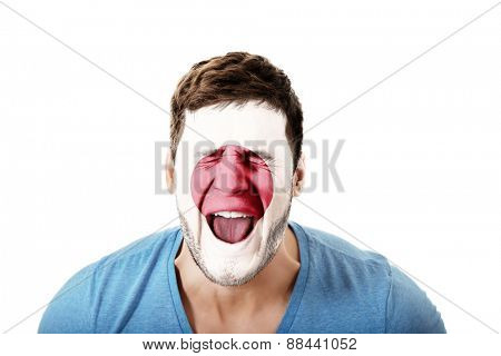 Screaming man with Japan flag painted on face.