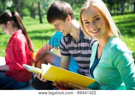 Female student outdoors with her friends