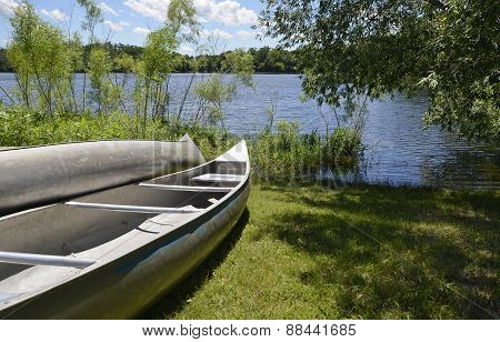 Canoes on the Grassy Bank