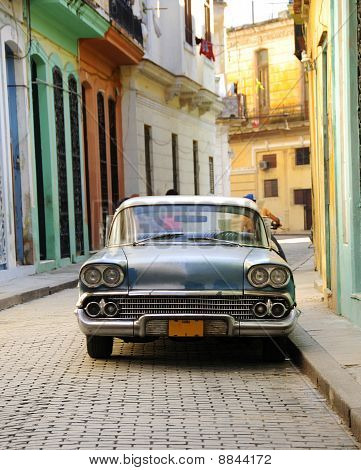 Old American Car Parked In Havana Street