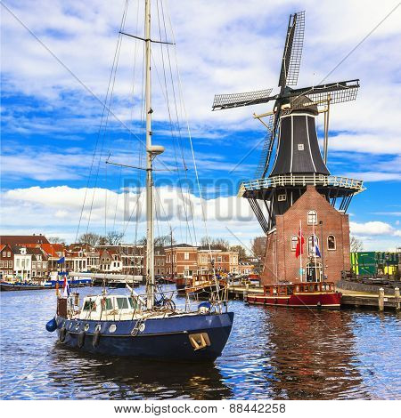 Holland, Haarlem' canals. view with traditional windmill and sai