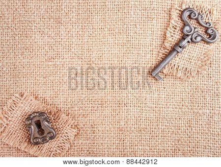 Burlap Background With Keyhole And Key