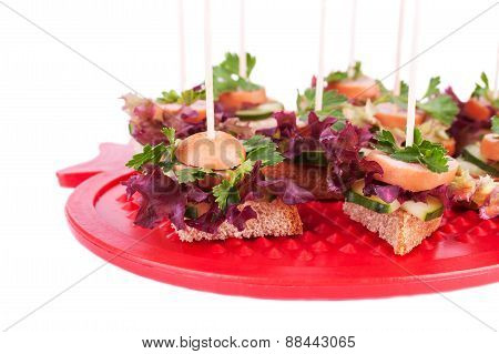 Canapes With Bread, Salad, Parsley, Cucumber And Sausages