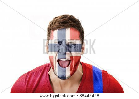Screaming man with Norway flag painted on face.