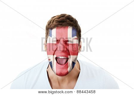 Screaming man with Great Britain flag painted on face.