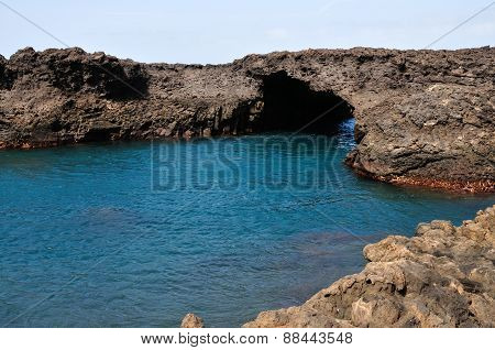 Volcanic Arch Over Water