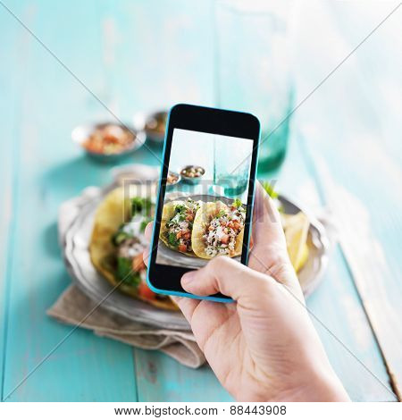 taking photo of tacos with smart phone