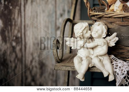 Figurines Angels Sitting On A Bench