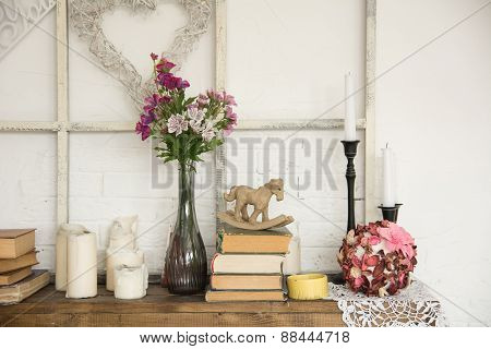 Interior With Books Flowers And Candles