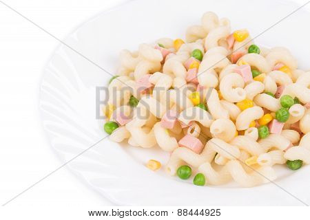 Pasta cavatappi with vegetables and sausage.