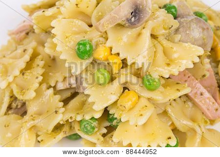 Pasta shells with vegetables and sausage.