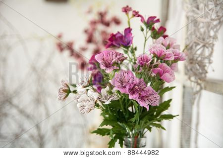 Bouquet Of Artificial Flowers On A Light Background Design