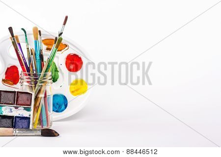 paints brushes and paints palette