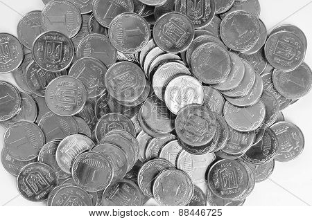 an abstract background with the Ukrainian coins