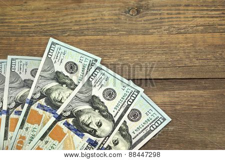 Usa New One Hundred Dollar Bills On The Wood Table