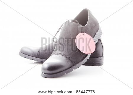 men's dress shoes with red price tag on a white background, close-up