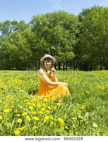 Woman On Meadow With Yellow Dandelions