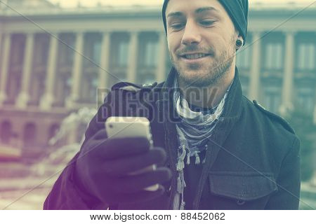 Traveling Man With Mobile Phone And Hat, In City, Urban Space