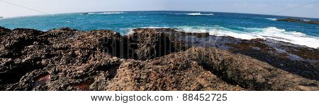 Waves Smash Into Volcanic Rocks