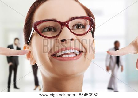 Smiling woman showing her perfect white teeth.