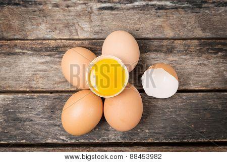 Chicken Brown Eggs On Wooden Background