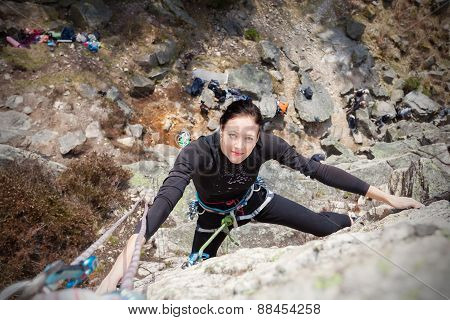 Happy Young Woman Climbing Wall.