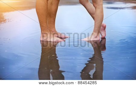 Feet in puddle