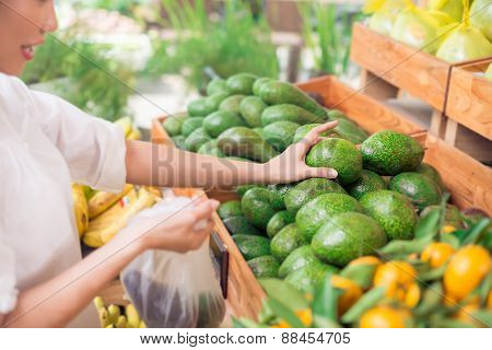 Picking up avocadoes