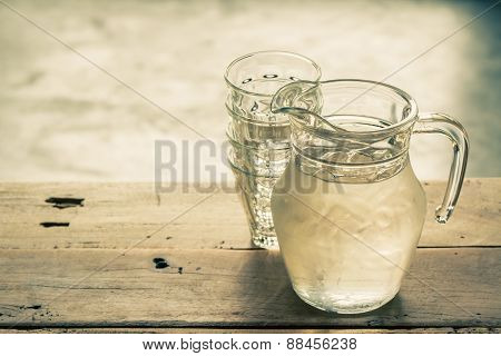 Glass Pitcher Of Water And Glass.