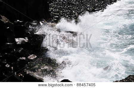 Waves Crash Against The Rocky Banks