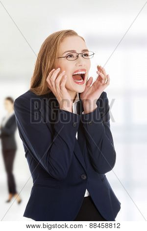 Beautiful businesswoman in shock expression.