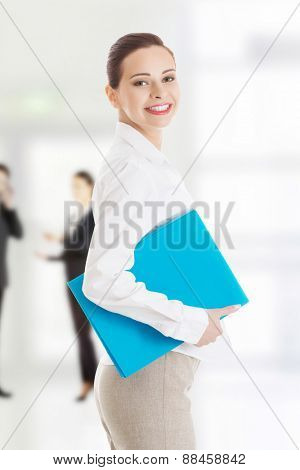 Confident happy businesswoman with notepad.