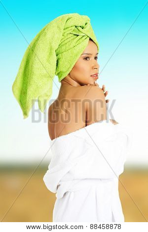 Beautiful woman undressing her bathrobe.