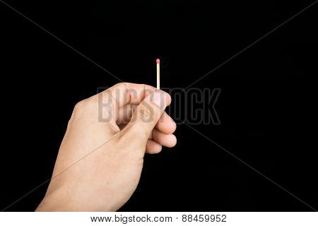 Matchstick In Hand Isolated On Black Background