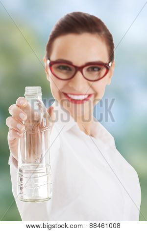 Businesswoman in eye glasses with bottle of water.