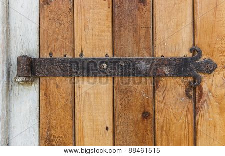 Old Wooden Door With An Old Cast Iron Door Hinges