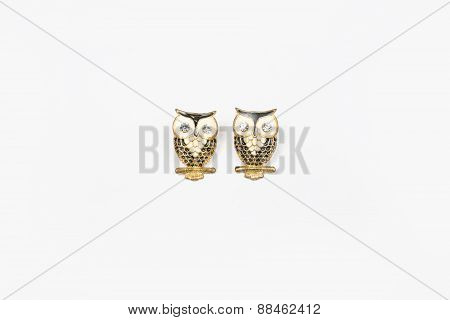 owl earring on white background.