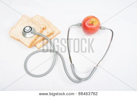 Stethoscope With Red Apple Isolated On White