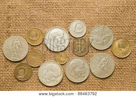 A Few Old Coins Of The Soviet Union On The Old Fabric