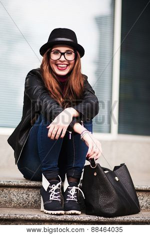 The Stylish Laughing Happy  City Girl In Sunglasses  Sits On Steps