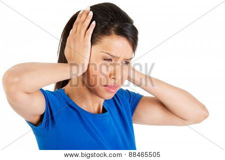 Portrait of a woman with huge headache.