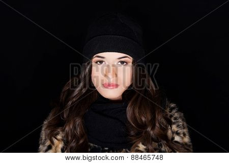 Portrait of a woman wearing warm clothes.