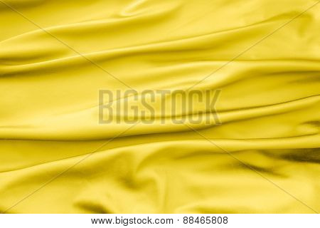 Soft Velvet Piece Of Yellow Fabric With Folds