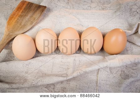 Chicken Brown Eggs With Spoon In Sackcloth