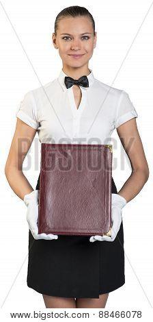 Waitress with smile in white gloves holding folder