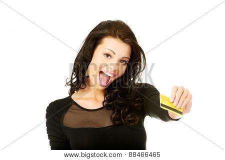 Happy cheerful woman holding credit card.